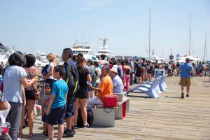 A summer crowd enjoying the HarborWalk